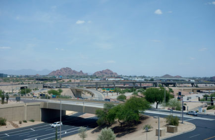 Phoenix, US - May 23, 2015: Mid-day rare low traffic in and out of Phoenix Sky Harbor International Airport near East Economy Parking Lot with Papago Park buttes in the distance, Arizona