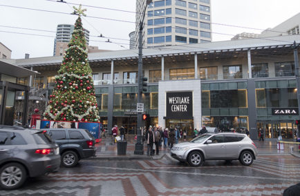 Seattle, Washington, USA - December 24, 2015: Holiday Shopper Tourists Outside the Entrance to Westlake Center Mall in Downtown Seattle.