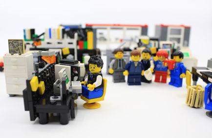 Hong Kong, ?hina - March 26, 2015:  Studio shot of Lego people in office, combine from different set. Legos are a popular line of plastic construction toys manufactured by The Lego Group in Denmark