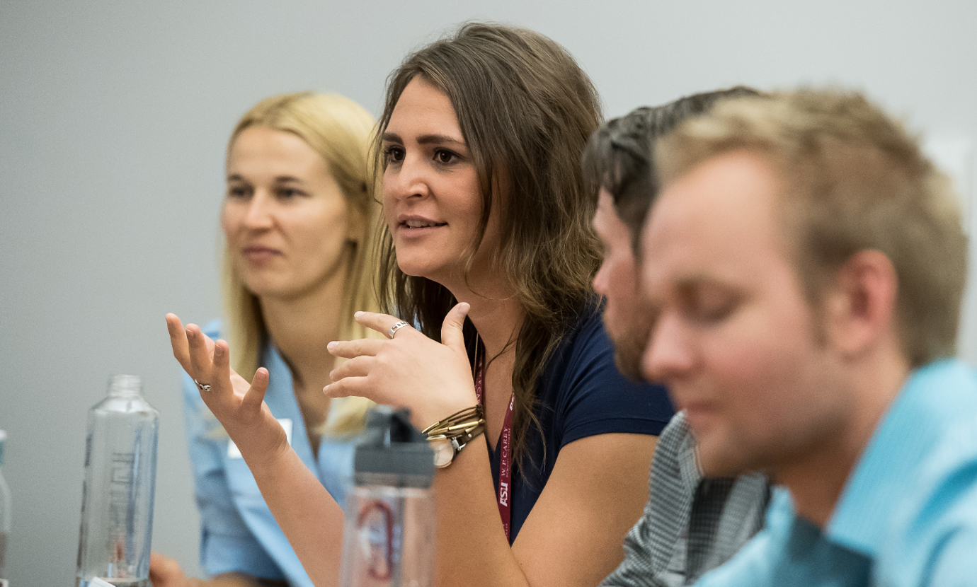 W. P. Carey Graduate Students Conversing